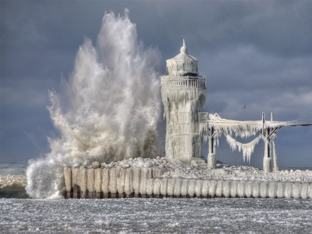 Lighthouse on Lake Michigan in Winter - During winter the icy waves crash to the pier of lighthouse on Lake Michigan and frost it. As a result, the amazing ice formations cover the lighthouse and look like from a magical fantastical fairytale. On the St. Joseph pier there were built over a century ago two lighthouses (10.5 m and 17.4 m tall), which stand guard under the onslaught of the powerful spray. - , lighthouse, lighthouses, lake, lakes, Michigan, winter, nature, natures, icy, waves, wave, pier, piers, result, results, amazing, ice, formations, formation, magical, fantastical, fairytale, fairytales, St., saint, Joseph, century, guard, guards, onslaught, powerful, spray - During winter the icy waves crash to the pier of lighthouse on Lake Michigan and frost it. As a result, the amazing ice formations cover the lighthouse and look like from a magical fantastical fairytale. On the St. Joseph pier there were built over a century ago two lighthouses (10.5 m and 17.4 m tall), which stand guard under the onslaught of the powerful spray. Solve free online Lighthouse on Lake Michigan in Winter puzzle games or send Lighthouse on Lake Michigan in Winter puzzle game greeting ecards  from puzzles-games.eu.. Lighthouse on Lake Michigan in Winter puzzle, puzzles, puzzles games, puzzles-games.eu, puzzle games, online puzzle games, free puzzle games, free online puzzle games, Lighthouse on Lake Michigan in Winter free puzzle game, Lighthouse on Lake Michigan in Winter online puzzle game, jigsaw puzzles, Lighthouse on Lake Michigan in Winter jigsaw puzzle, jigsaw puzzle games, jigsaw puzzles games, Lighthouse on Lake Michigan in Winter puzzle game ecard, puzzles games ecards, Lighthouse on Lake Michigan in Winter puzzle game greeting ecard